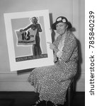 Small photo of Woman holding a 1931 poster 'Abolish Prohibition!' In 1933 state conventions ratified the Twenty-first Amendment, which repealed Prohibition