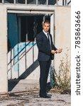 handsome man in black suit and... | Shutterstock . vector #785863666