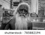 Small photo of October 12,2017. Monochrome portrait of a sadhu Baba posing with blessing hand in Varanasi, Utter Pradesh,India.