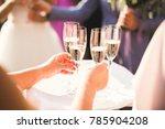 waiter serving glasses with... | Shutterstock . vector #785904208