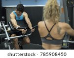 man training biceps in exercise ... | Shutterstock . vector #785908450