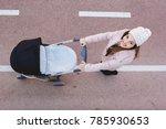 portrait of happy young mother... | Shutterstock . vector #785930653