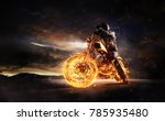 dark motorbiker staying on... | Shutterstock . vector #785935480