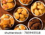 mixed brazilian snack on the... | Shutterstock . vector #785945518