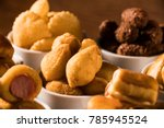mixed brazilian snack on the... | Shutterstock . vector #785945524