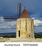 Small photo of The windmill made famour by the writings of Alphonse Daudet at Fontvieille, Bouches du Rhone in Provence and painted by Vincent Van Gogh