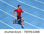 sprinter man running on blue... | Shutterstock . vector #785961688