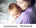 happy caring mother holding... | Shutterstock . vector #785966248