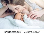 happy caring mother holding... | Shutterstock . vector #785966260