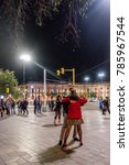 Small photo of CORDOBA, ARGENTINA - SEPTEMBER 30, 2017: MILONGA TANGO DANCERS ON THE STREET AT NIGHT.