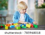 adorable little boy playing... | Shutterstock . vector #785968018