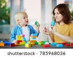 young mother playing colorful... | Shutterstock . vector #785968036