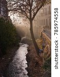 Small photo of GRANADA, ANDALUCIA, SPAIN - DECEMBER 20, 2017: Tree and river on Carrera del Darro in afternoon sunhaze on December 20, 2017 in Granada, Andalucia, Spain