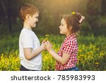 little boy gift flowers his...   Shutterstock . vector #785983993