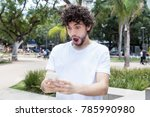 surprised young adult hipster... | Shutterstock . vector #785990980