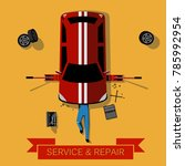 mechanic lies under the car and ... | Shutterstock .eps vector #785992954