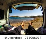 Couple Inside A Campervan And...