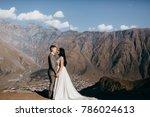 wedding couple near the church    Shutterstock . vector #786024613