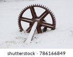 old rusty wheel in the snow | Shutterstock . vector #786166849