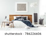 navy blue blanket on white bed... | Shutterstock . vector #786226606