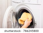 woman loading laundry to the... | Shutterstock . vector #786245800