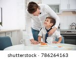 young father helping his little ... | Shutterstock . vector #786264163