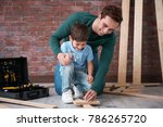 father teaching his little son... | Shutterstock . vector #786265720