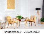 wooden table between yellow...   Shutterstock . vector #786268060