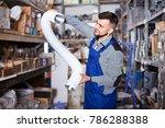 smiling male worker deciding on ... | Shutterstock . vector #786288388