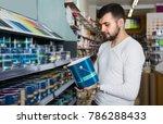 man is deciding on best wall... | Shutterstock . vector #786288433