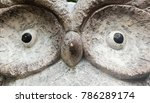 Small photo of a stone owl with an indecipherable look