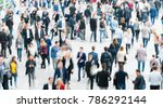 blurred people at a trade fair... | Shutterstock . vector #786292144