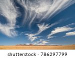 Wispy Clouds In Desert