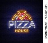 pizza logo emblem neon sign.... | Shutterstock .eps vector #786304684