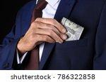 businessman putting money in...   Shutterstock . vector #786322858