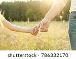 the parent holds the hand of a... | Shutterstock . vector #786332170
