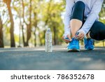young athlete woman tying... | Shutterstock . vector #786352678