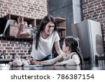 angry mother. serious young... | Shutterstock . vector #786387154