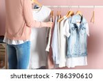 woman choosing clothes on rack... | Shutterstock . vector #786390610