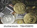 bitcoin coins laying on paper... | Shutterstock . vector #786458890