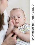 mother holding sleeping baby...   Shutterstock . vector #786465070