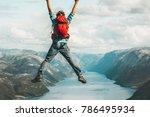 happy man jumping above...   Shutterstock . vector #786495934