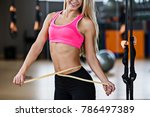 muscular woman measures her... | Shutterstock . vector #786497389