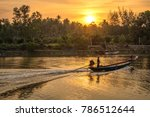 long tail boat in estuary with ... | Shutterstock . vector #786512644
