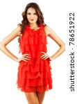 woman in red dress with long curly hair on white background - stock photo