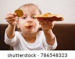 golden bitcoin in a child hand... | Shutterstock . vector #786548323