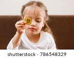 golden bitcoin in a child hand... | Shutterstock . vector #786548329