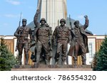 Small photo of MOSCOW, RUSSIA - AUGUST 20, 2017: Monument to the Allies, a bronze statue depicting four WO2 soldiers of the allied nations with the Museum of the Great Patriotic War at the background.