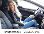 sexy young blonde woman in car. ... | Shutterstock . vector #786600148