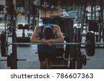 overtraining. male athlete... | Shutterstock . vector #786607363